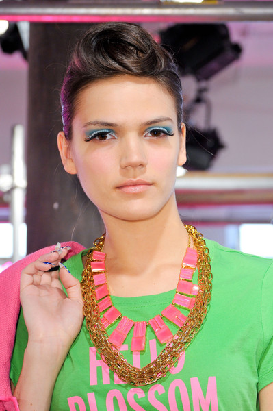 A Modern Twist on the 1040's Victory Roll or Rockabilly hairstyle at Kate Spade Spring 2013 Collection