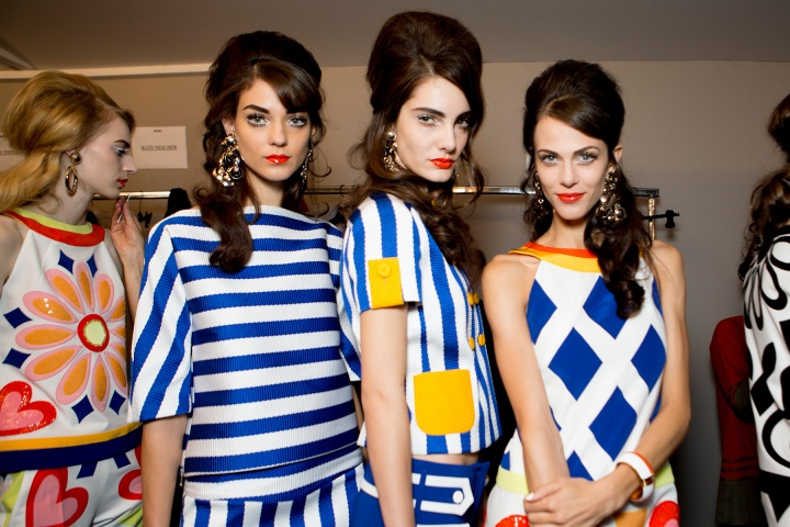 Moschino Ready-To-Wear Spring/Summer 2013 Collection has the models Looking Retro in the Geometric Print Clothing teamed with Half Up Hair that has Been Achieved by Getting Plenty of Volume in those Blowaves to Create a Beehive-Revival!