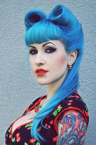 Rockabilly Girls do it well - double victory roll picture here.