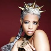 Kelis with a plait of extensions