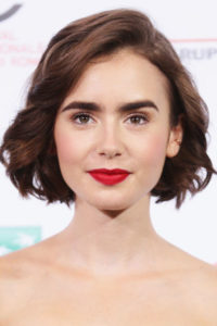 Lily Collins looks fresh with her chin-skimming blunt bob. The tousled texture opens up her face and add softness to her overall look.