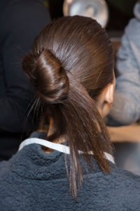 Sleek glossy knotted bun with ends exposed - a quick and modern take on the upstyle