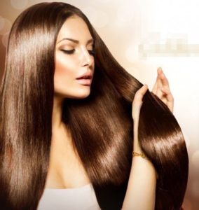 woman who has received a kerasilk keratin treatment showing smooth long hair