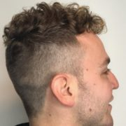 Mens short hairstyle with undercut and universal long top and fringe showing texture and curl. Haircut by Nadine Behrendt at Lily Jackson Hair & Makeup